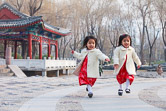 Chinese twins playing in Ritan Park, Chaoyang District, Beijing. 21.12.11