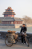Sweet potato seller in the north west corner out of the Forbidden City. Beijing 28.02.09