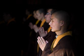 Buddhist monks praying inside the Fayuan temple in Beijing