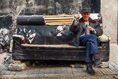 An old sofa used as a bench in a hutong. Beijing. 09.03.08