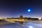 Moon shining over the north west corner of the Forbidden City in Beijing. 16.02.12 Time: 05:49
