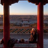 Old man doing exercise at sunrise on the top of Jingshan Park. Just below is the north entrance of the Forbidden City. Beijing. 16.02.12