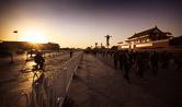 A man passing through Tiananmen square during sunset. Beijing 22.11.11